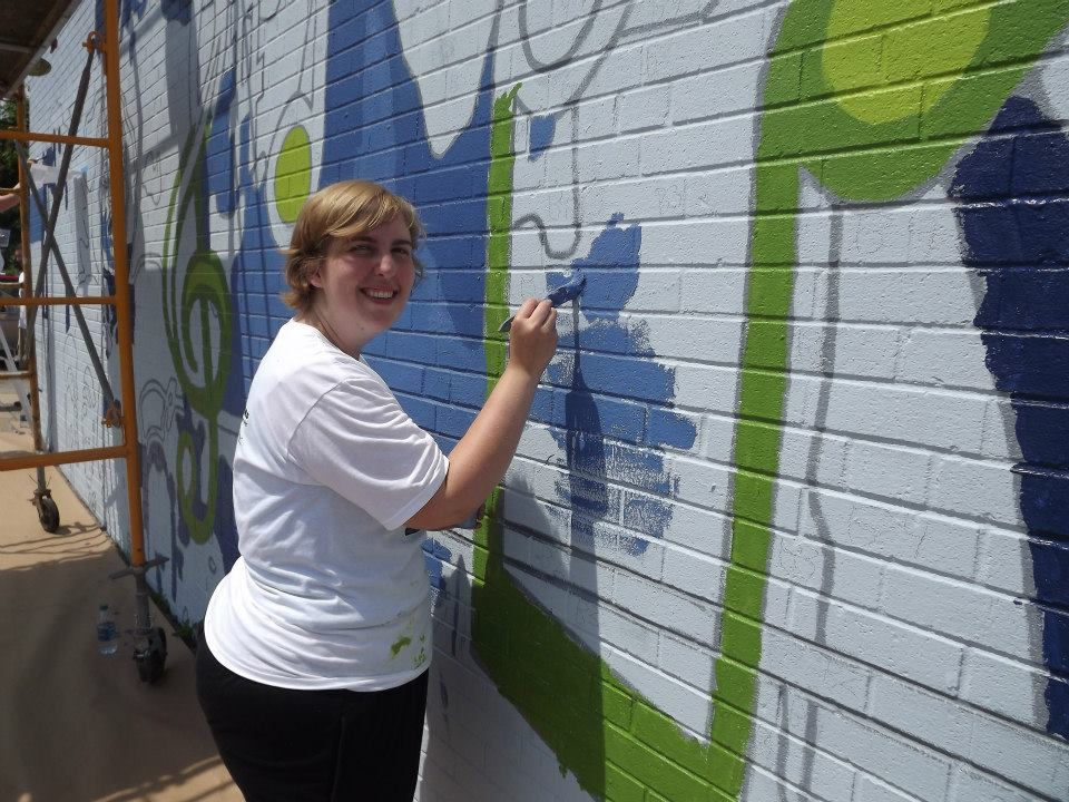 Painting a mural on a school in North Philadelphia for Eagles Day
